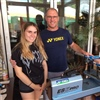 Tournament director Christopher Rummel and his daughter string over 100 rackets in 3 days